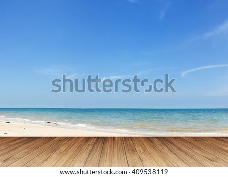 Perspective of wood terrace against beautiful seascape with free copy space use for background or backdrop. - stock photo