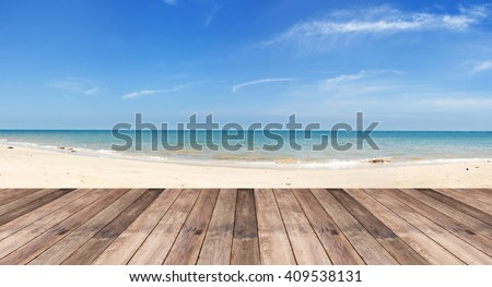 Perspective of wood terrace against beautiful seascape with free copy space use for background or backdrop.