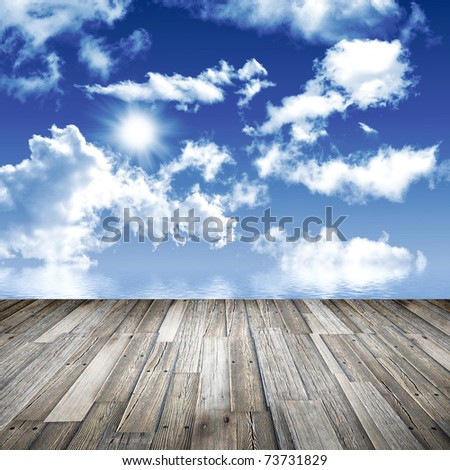Perspective old wood floor and cloudy sky - stock photo
