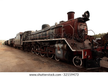 perspective on old rusty steam engine - stock photo