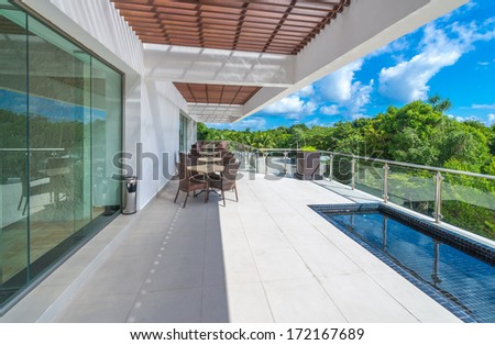 Perspective, outlook at the modern stylish balcony, deck, patio of the restaurant, cafe, bar of the luxury Mexican resort. Exterior, interior design.