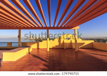 Perspective, outlook at the modern stylish balcony, deck, patio of the restaurant, cafe, bar of the luxury Mexican resort. Exterior, interior design.  - stock photo