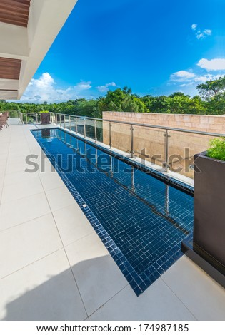 Perspective, outlook, panorama at the modern glass and steel balcony, deck, promenade railing and the water pool as an decor design. Exterior, interior design. - stock photo