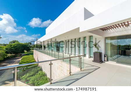 Perspective, panorama at the modern glass and steel balcony, deck, promenade with glass and steel railing. Exterior, interior design. - stock photo