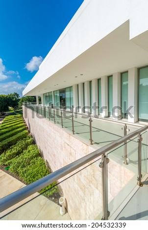 Perspective, panorama at the modern glass and steel balcony, deck, promenade with glass and steel railing. Exterior, interior design. Vertical. - stock photo