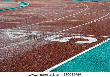 Perspective picture of start or finish position on running track - stock photo