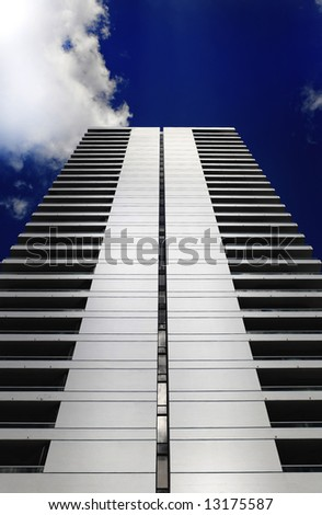 Perspective shot of a skyscraper that resembles a modern day pyrimid look.