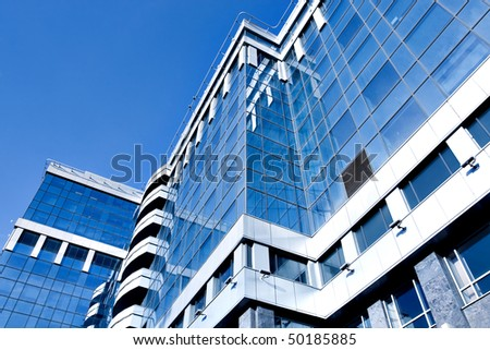 perspective side of modern geometric skyscrapers - stock photo