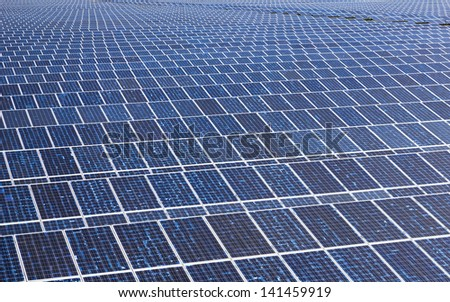 perspective solar cell installed on platform with blue sky - stock photo