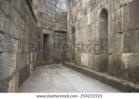 perspective street background between stones gray old retro block brick wall Decorative cross pattern Clean ground No people Empty space for inscription object or people Armenian orthodox church