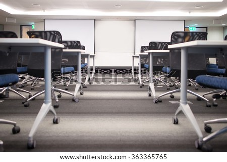 Perspective to blank screen in front of the meeting room - stock photo