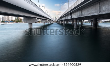 Perspective View Below the Southport Sundale Bridge During The Evening And Overlooking The Gold Coast City Skyline, Nerang River, Queensland, Australia - stock photo