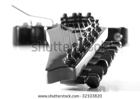 Perspective view of a black electric guitar. - stock photo