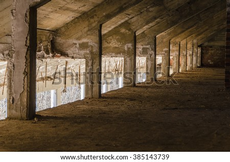 Perspective view of an abandoned attic. Urban decay - stock photo