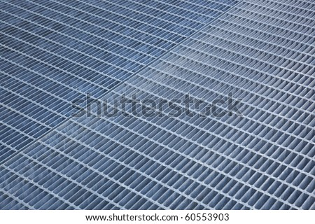 Perspective view of an iron grate - stock photo