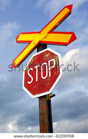 Perspective view of an old and rusty stop railroad sign - stock photo