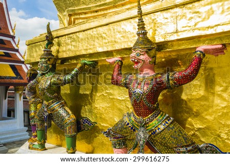 Perspective view of demon guardians supporting Wat Arun Temple, Bangkok, Thailand  - stock photo