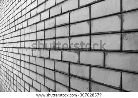 Perspective view of dirty white silicate brick wall
