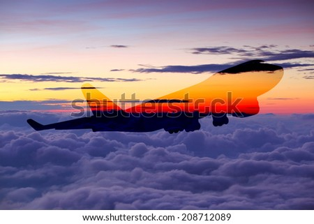 perspective view of jet airliner in flight on sky over cloud at sunrise time it's very beautiful , use for air transport ,journey and travel industry business - stock photo