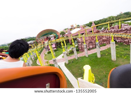 Perspective view of roller coaster - stock photo