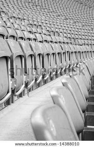 Perspective view of rows of grey empty stadium seats