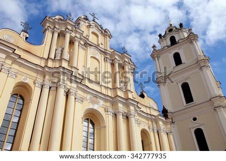 Perspective view of St John's Church in Vilnius University, Vilnius, Lithuania on blue sky background - stock photo