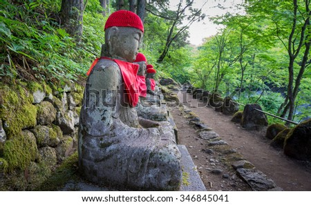 Perspective view of statues of Jizo in Nikko, Japan. Wide angle with shallow depth of field