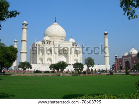 Perspective view of Taj Mahal mausoleum over the lawn, in the city of Agra, India. - stock photo