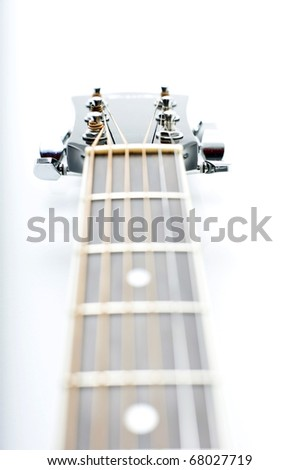 Perspective view of the acoustic guitar head, isolated on the white background. - stock photo