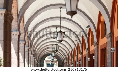Perspective view of the corridor with hanging lamps from the floor. - stock photo