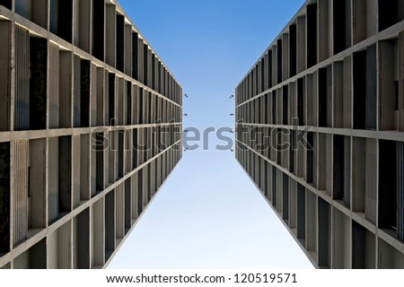 Perspective view of the residential skyscrapers and blue sky. - stock photo