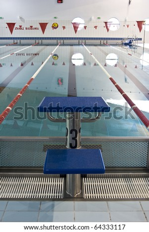 perspective view on starting platform on swimming pool - stock photo