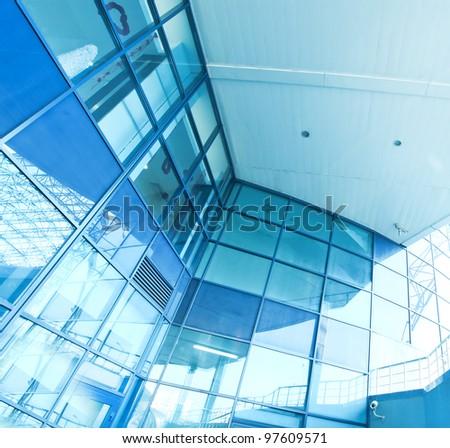 perspective view to advanced glass skyscraper - stock photo