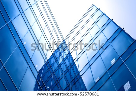 perspective view to blue business glass skyscraper, office center - stock photo