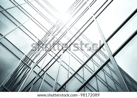 Perspective view to dark high rise glass skyscrapers at night - stock photo