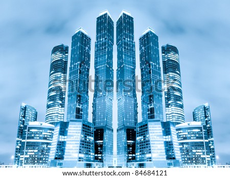 perspective view to glass high-rise building skyscrapers at nigh - stock photo