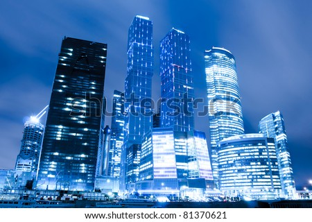 perspective view to glass high-rise skyscrapers of Moscow city business center at night - stock photo