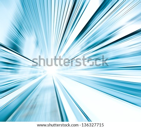 Perspective wide angle view of modern light blue illuminated and spacious high-speed and technology moving escalator with fast blurred trail of handrail in vanishing traffic motion - stock photo