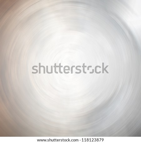 Perspective wide angle view to modern light blue metal background with illuminated and spacious futuristic hole, fast blurred trail of round lines in vanishing traffic motion - stock photo