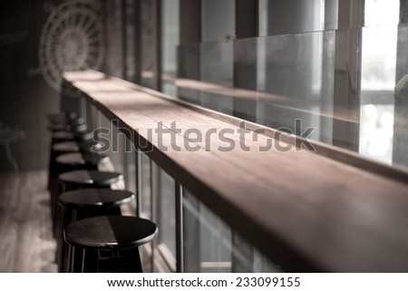 perspective wooden table in bar space - stock photo