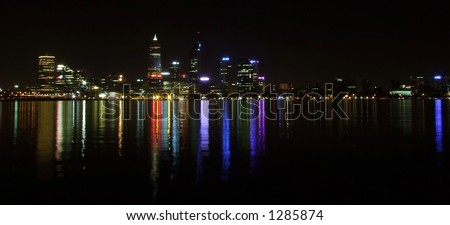 Perth city at night with reflections in the Swan River waters - stock photo