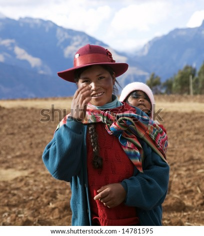 PERU - AUGUST 1: A native Peruvian woman gestures while carrying a baby August 1, 2007 in Sacred Valley, Peru.