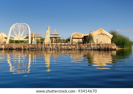 Peru, floating Uros islands on the Titicaca lake, the largest highaltitude lake in the world (3808m). Theyre built using the buoyant totora reeds that grow abundantly in the shallows of the lake. - stock photo