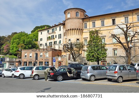PERUGIA, ITALY - APRIL 19: Cars parked on the shore of Lake Trasimeno on April 19, 2011 in Perugia,Italy. It's the largest lake on the Italian peninsula, part of the province of Perugia. - stock photo