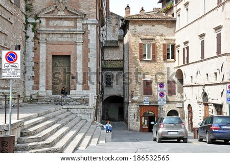 PERUGIA, ITALY- APRIL 22: People in old town on April 22, 2011 in Perugia, Italy. Perugia hosts Jazz, Chocolate and Journalism festivals attracting many tourists each year. - stock photo