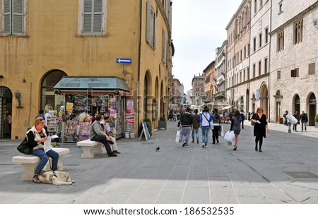 PERUGIA, ITALY- APRIL 22: Tourists and citizens on April 22, 2011 in Perugia, Italy. Perugia hosts Jazz, Chocolate and Journalism festivals attracting many tourists each year. - stock photo
