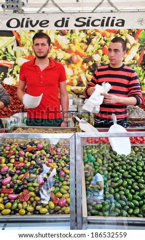 PERUGIA, ITALY- APRIL 22: Vendors at olive shop on April 22, 2011 in Perugia, Italy. Perugia hosts Jazz, Chocolate and Journalism festivals attracting many tourists each year. - stock photo