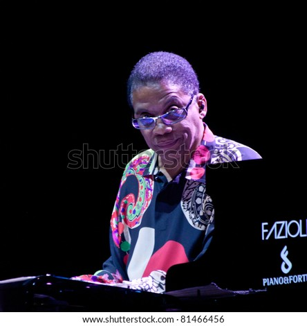 PERUGIA, ITALY - JULY 9 : Herbie Hancock  plays piano and keyboards on main stage at Umbria Jazz Festival - July 9, 2011 in Perugia, Italy - stock photo