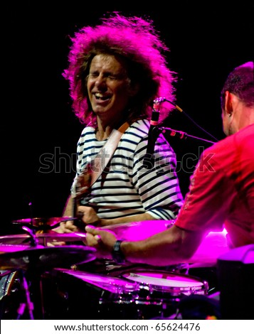PERUGIA, ITALY - JULY 15: Pat Metheny Group (Pat Metheny -guitar, Lyle Mays -keyboards, Steve Rodby -bass, Antonio Sanchez -drums) on stage at Umbria Jazz Festival - July 15, 2010 Perugia, Italy - stock photo