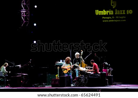 PERUGIA, ITALY-JULY 15: Pat Metheny Group (Pat Metheny -guitar, Lyle Mays -keyboards, Steve Rodby -bass,Antonio Sanchez -drums) on stage at Umbria Jazz Festival - July 15, 2010 in Perugia, Italy - stock photo
